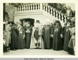 Feodor Pashkovskii and a group of people including four Russian Orthodox clergy standing outdoors...