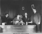 Gov. Clark of Alaska signing the Shoup Women Suffrage Bill. First bill passed by First...