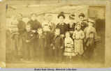 Group portrait of women and children taken in Unga about 1887.