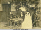 Father Ieromonk Mefodii, left, catechizer Simeon Kakvaim and wife.