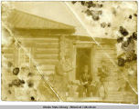 Four men in front of log house, probably in Siberia.