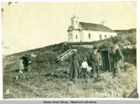 Exterior of church on hill in Nushagak.