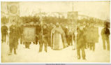 Religious procession in Afognak, Alaska. Rev. V. Kashevaroff in robes.