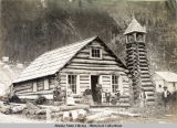 Log Cabin Church, Juneau. Exterior view with people on and near porch.