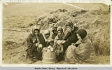 Aleutian women weaving the famous Attu baskets.