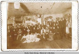 Unidentified group of people in decorated room.