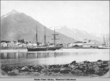 Three-masted ship anchored in Sitka harbor.