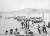 Canoes arriving in Sitka. 1904?