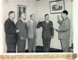 George (Tony) Schwamm being sworn in as first Director of Aviation for Territory of Alaska, July...