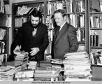 "Dick Engen, State Librarian and Lt.Gov. Henry ""Red"" Boucher view books. (Early 1970s)."