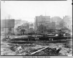 Empty lot at site of future Capitol. Early stage of construction of Capitol Building.