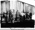 Ixterior [exterior] of chief's house. Chilkat Indians in old dancing costumes, Alaska. c. 1895.
