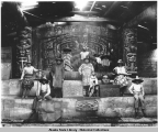 Interior of Chief Klart-Reech's House, Chilkat, Alaska. Indians in old dancing costumes. c. 1895.