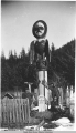 Indian Totems and Graves, Fort Wrangel [Wrangell], Alaska.