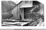 Wooden shelter with machinery at Nugget Creek.
