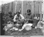 Native Women Weaving Baskets, Sitka, Alaska. Copyright 1897.