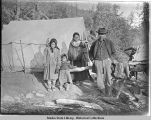Native family in front of tent.