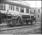 "Skagway: two horses pull wagon decorated with sign ""Skagway Daily Alaskan. The first daily..."