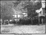 Parade along main street in Skagway; probably 4th of July.