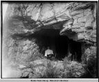 Vera Soboleff, in teens, sitting in mouth cave.