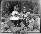 Ethel and Vera Bayers sitting on rocks.