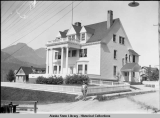 Governor's Mansion from the southeast; Governor Scott C. Bone standing on the corner in the...