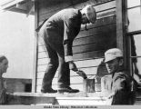 President Harding painting siding of new railroad section house at Willow.