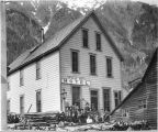 Group of men posing outside the Juneau City Hotel.