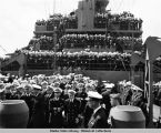 Officers in foreground and men in background on deck, ready for Japanese surrender.