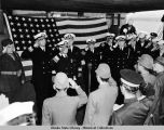U.S. Naval officers standing opposite Japanese officials and Lt. Gen. Toshimoto Hoshimo on...