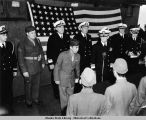 U.S. Naval officers and Japanese officials at Japanese surrender ceremony.
