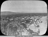Settlement on river with paddleboats / sternwheelers lantern slide.