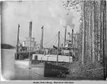 Three riverboats tied up to river bank: New York, T. Crowel(?) and Monarch.