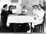 Nurses at dining table.