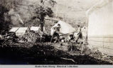 Men cutting wood for camp [Bonanza City].