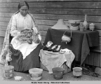 Tlingit Indian basket weaver, circa 1905.