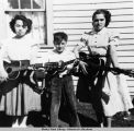 Harry (holding ukelele), Edna and Martha Krukoff (both with guitars).