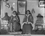 Two native Sitka women seated in room.