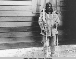 An inland Eskimo who has come with invitation represented by notches on the sticks to a dance...