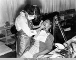 Eskimo children receiving dental work, 1955.