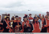 Outdoor view of natives in regalia.