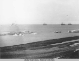 View of four three-masted whaling ships offshore from Barrow.