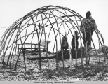 Tent frame made from willows bent into shape.