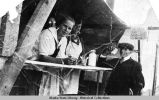 Dorothy Olsen and others serving hot dogs, Hoonah AK, 4th of July C.A. 1919.