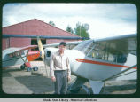 Don Sheldon, with aircraft, Talkeetna, Alaska, 1954.
