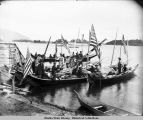 Guests arriving in decorated canoes for 1904 potlatch.