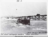 Cat stuck salvaging material from overflow. Knik Bridge Nov. 27, 1935.