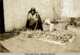 Woman selling moccasins.