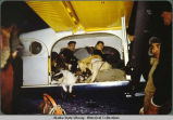 George Attla Jr. with dogs and sleds piled in Wien's Pilatus Porter aircraft.