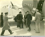 Officer greeting Ernest Gruening exiting plane, Dutch Harbor(?).